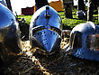 Suit Of Armor. Medieval Metal Helmets On The Straw stock photo