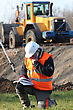 Excavator Surveyor Working On-site stock photo