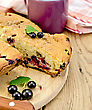 Sweet Cake With Black Currant, Napkin, Knife, Cup On The Background Of Wooden Boards