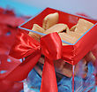 Sweet Cookies In Red Gift Box With Red Bow