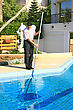 Swimming Pool Cleaner At Work stock image