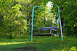 A Swinging Bench Deep In The Woods stock photo