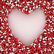 Symbol Of Heart Made From Red Capsules