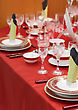 Table Appointments On Red Tablecloth.Accent Focus On Front stock photography