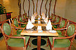 Table With Chairs Prepared For Dinner In Restaurant stock image