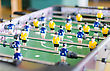 Championship Table Football Game With Yellow And Blue Players stock image