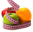 Tape Measure Wrapped Around Fruits Isolated On White Background stock photo