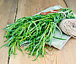 Tarragon Fresh Green With A Ball Of Twine And A Knife On A Napkin On The Background Of Wooden Boards stock photo