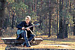 Teen Musician Plays The Guitar In The Autumn Forest stock photography