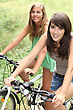Biking Teenage Girls Riding Their Bikes stock photography