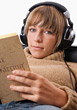 Teenager with Headphones & Book stock photo