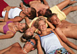 Teenagers Laying in Sand stock image
