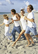 Teenagers Running to the Beach stock photography