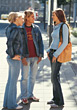 Teenagers Talking Standing on Sidewalk stock image