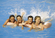 Teens in the Water Splashing stock image