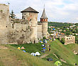 Tents Under Ancient Castle Walls stock photo