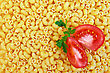 Texture Units Of The Yellow Pasta With Two Slices Of Tomato And A Sprig Of Parsley stock image