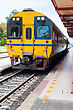 Thai Train Stop At Station With Railway