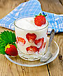 Thick Yogurt With Strawberries In A Glass With A Spoon On The Saucer, Napkin On A Wooden Board stock photography
