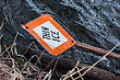 Thin Ice Sign In Water On Lake stock photo