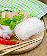Thin Rice Noodles With Garlic, Hot Red Pepper, Ginger, Basil, Napkin, Chopsticks On A Background Of Wooden Boards