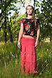 Thoughtful Blond Woman Posing In Red Skirt And Flowering Blouse stock photography