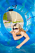 Thoughtful Young Blond Woman Posing With Rubber Ring In Swimming Pool