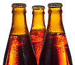 Three Amber Bottles With Beer stock image