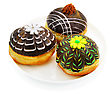 Three Beautiful Donut With Chocolate. Decorated With Flowers stock photography