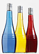 Three Bottles Of Colored Liquid stock photography
