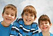 Playful Three Brothers stock photo