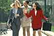 Three Business Woman Walking And Chatting Outside