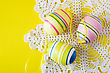 Three Colorful Easter Eggs On Decorative Serviette stock photo
