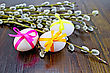 Three Easter Eggs Tied With Colored Ribbons, Willow Twigs On A Wooden Board stock photography