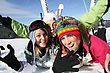 Skiing Three Friends Laying In The Snow With Ski Equipment stock photo