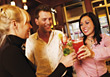 Three Friends Toasting Drinks At A Club stock image