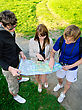 Three Friends Traveling, They Look At A Map stock image