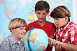 Three Kids Learning Geography stock image