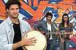Three Musicians In Front Of A Tagged Wall stock photography