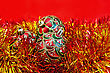 Three Red Christmas Ball With A Pattern In Red And Gold Tinsel On Red Background stock photo