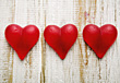 Three Red Hearts On Wood Background stock photo