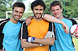 Three Smiling Footballers With Ball stock photo