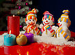 Three Snowmen And Burning Candles Over The Blue Background stock image