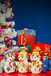 Three Snowmen In Front Of The Christmas Presents Over The Blue Background stock photography
