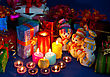 Three Snowmen In Front Of The Christmas Presents And Burning Candles stock image