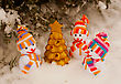 Three Snowmen With Golden Evergreen Tree Staying Outdoors