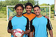 Three Young Footballers In Front Of Goal stock photo