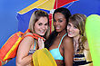 Three Young Women With Wearing Swim Wear stock photo