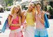 Three Young Women With Shopping Bags stock photo