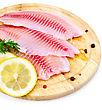 Tilapia Fillets With Dill, Lemon Slices, Peppercorns On A Wooden Board Isolated On White Background stock image